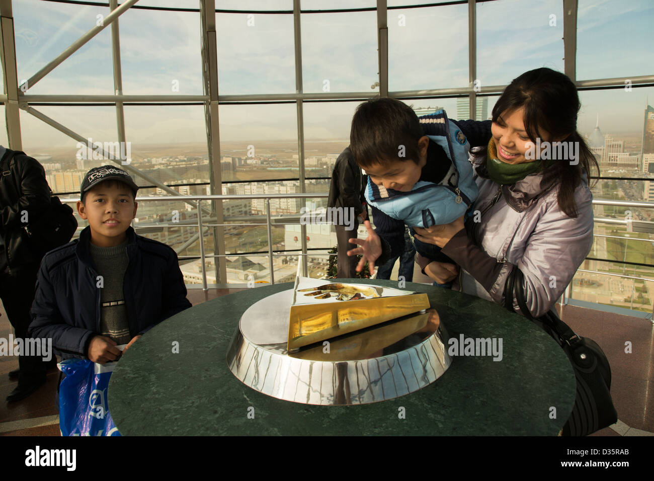 Visitors at the top of Baiterek tower with a handprint of Kazakh President Nursultan Nazarbayev above Astana, Kazakhstan Stock Photo