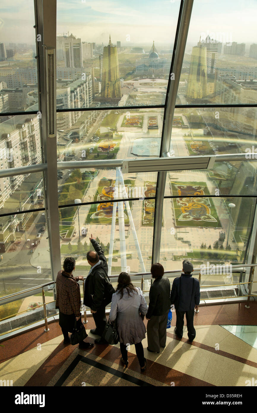 Visitors at the top of Baiterek tower taking in a view of Astana, Kazakhstan - Stock Image