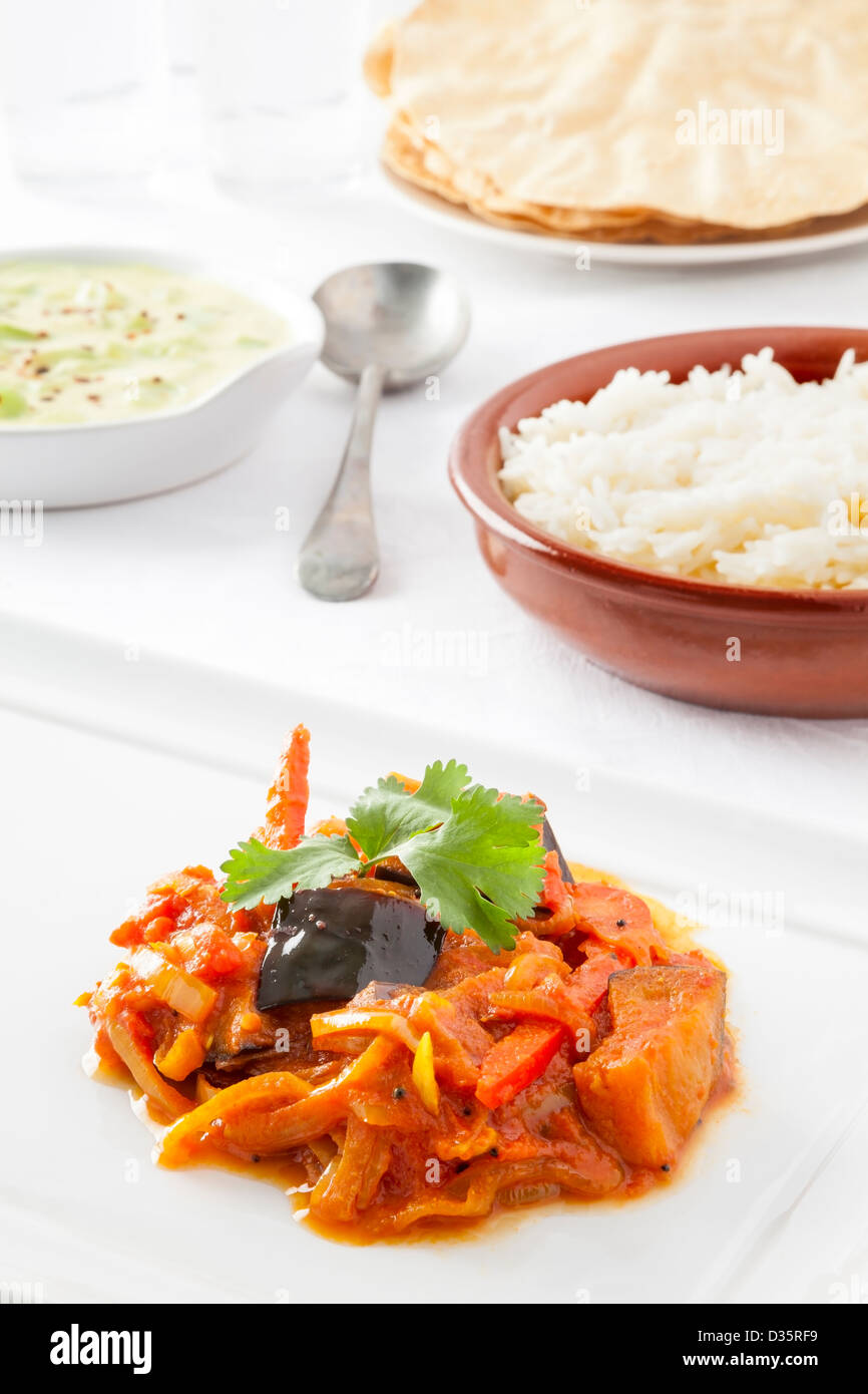 Aubergine tomato and red pepper curry - Stock Image