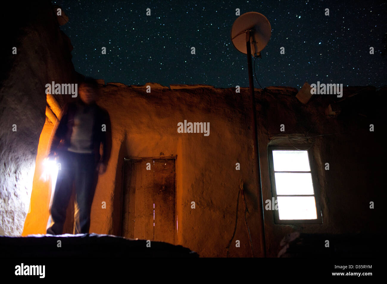 The village of Bedev, Tajikistan, uses solar electricity to support lighting and TV usage at night. - Stock Image