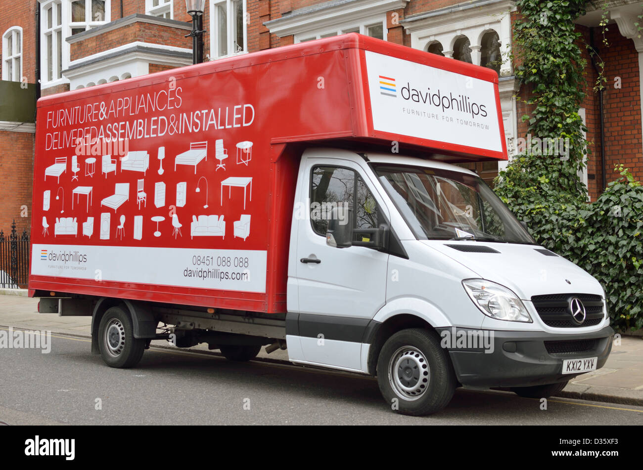 Red furniture delivery van stock image