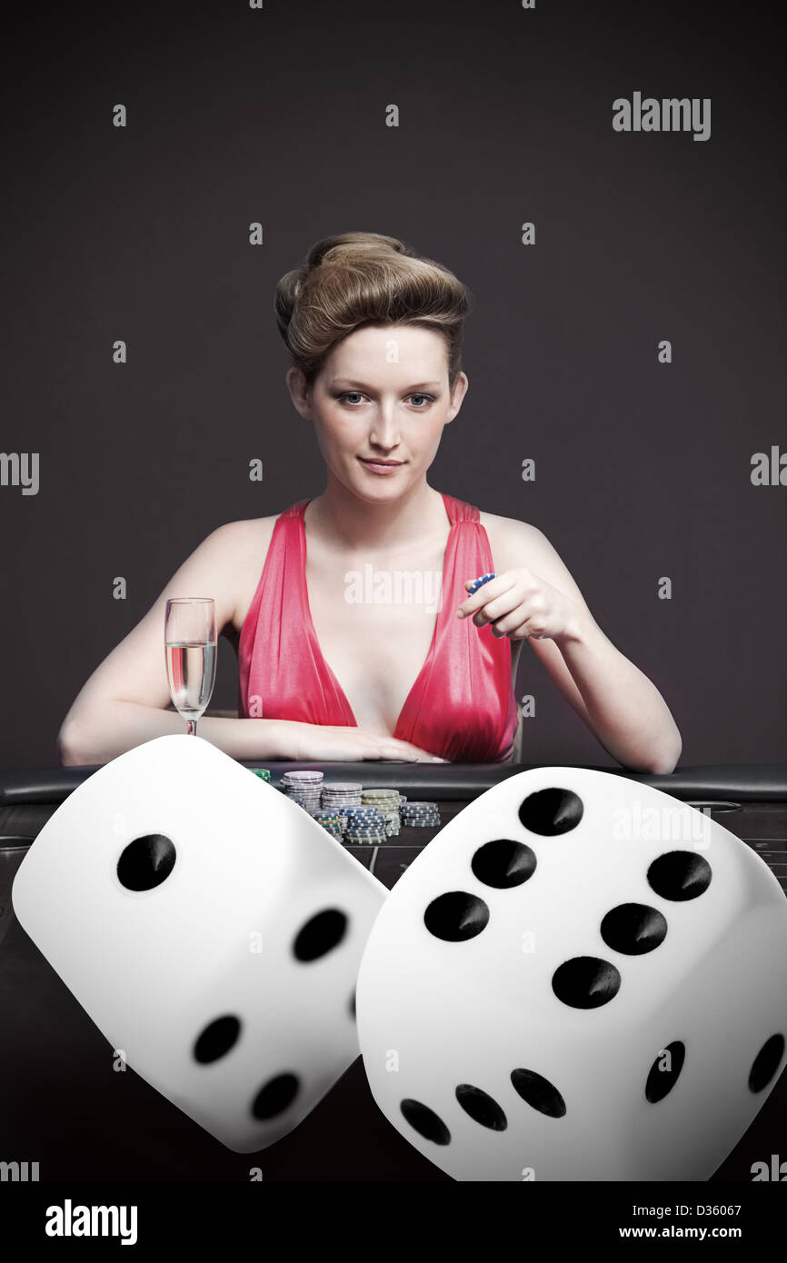 Attractive gambler betting on digital dice - Stock Image