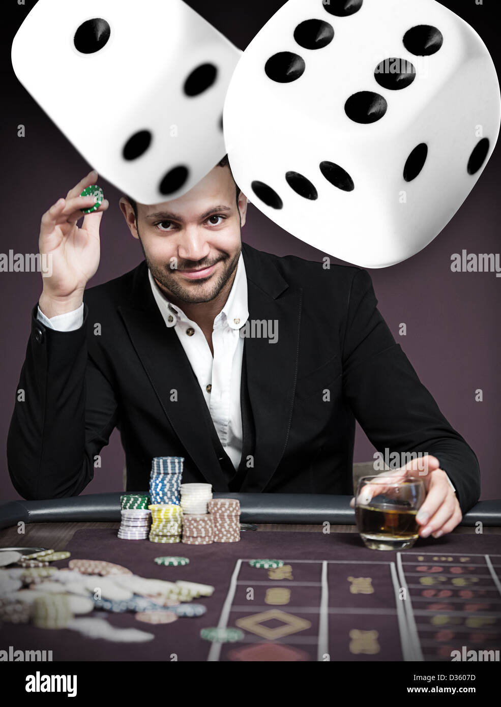 Handsome gambler with digital dice - Stock Image