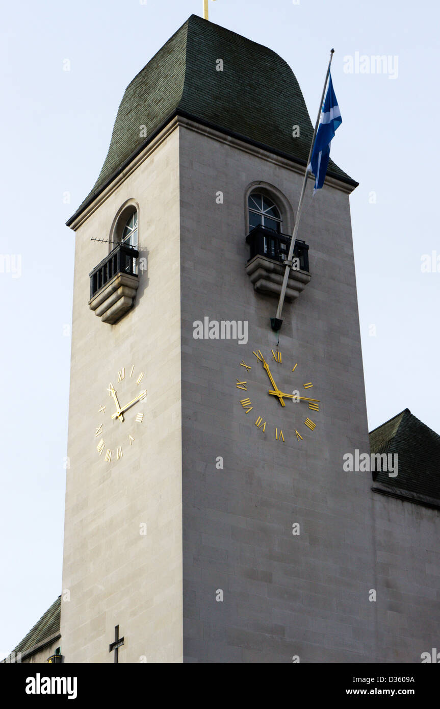 The clock tower of St Columba's Presbyterian Church of Scotland in Pont Street, London. - Stock Image