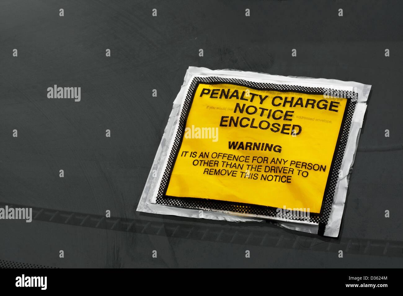Parking ticket stuck on car windscreen a penalty or fine - Stock Image