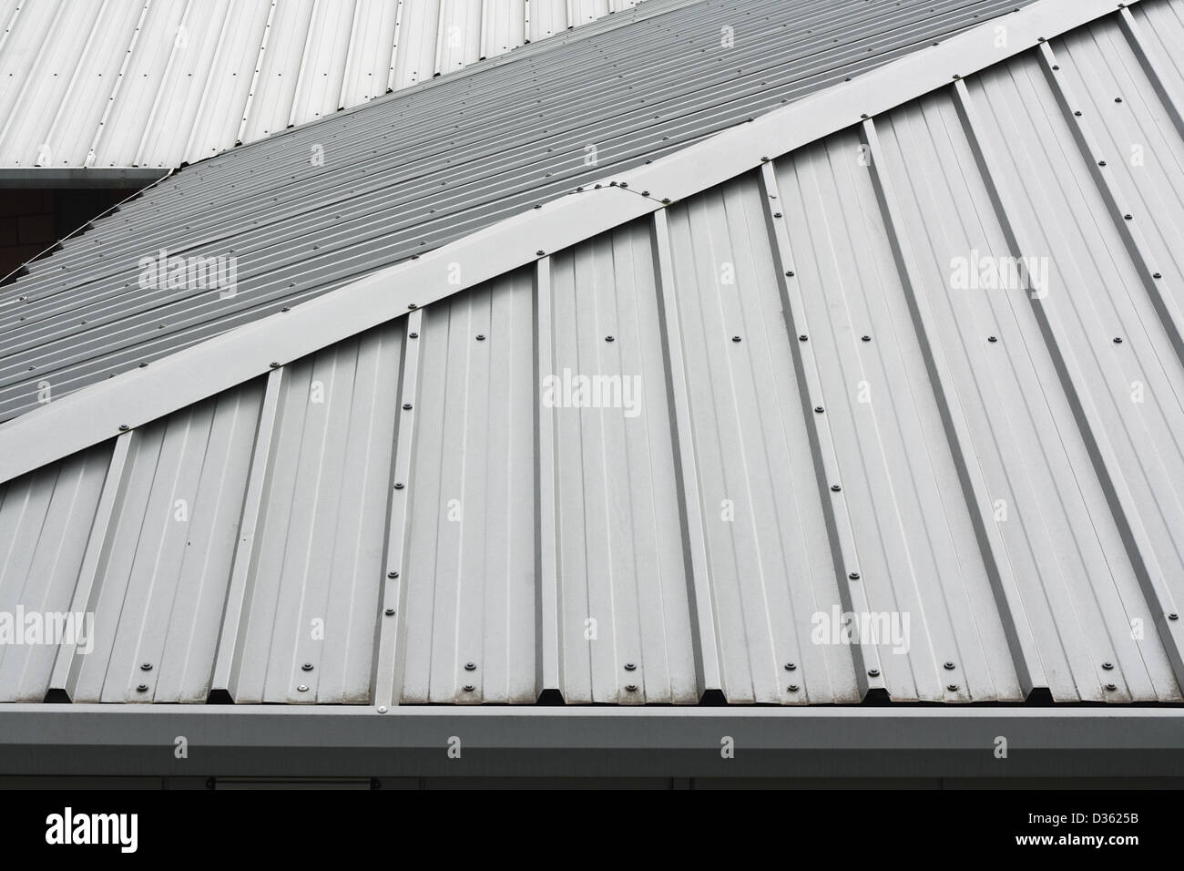 Architectural detail of metal roofing on commercial construction of modern building complex - Stock Image