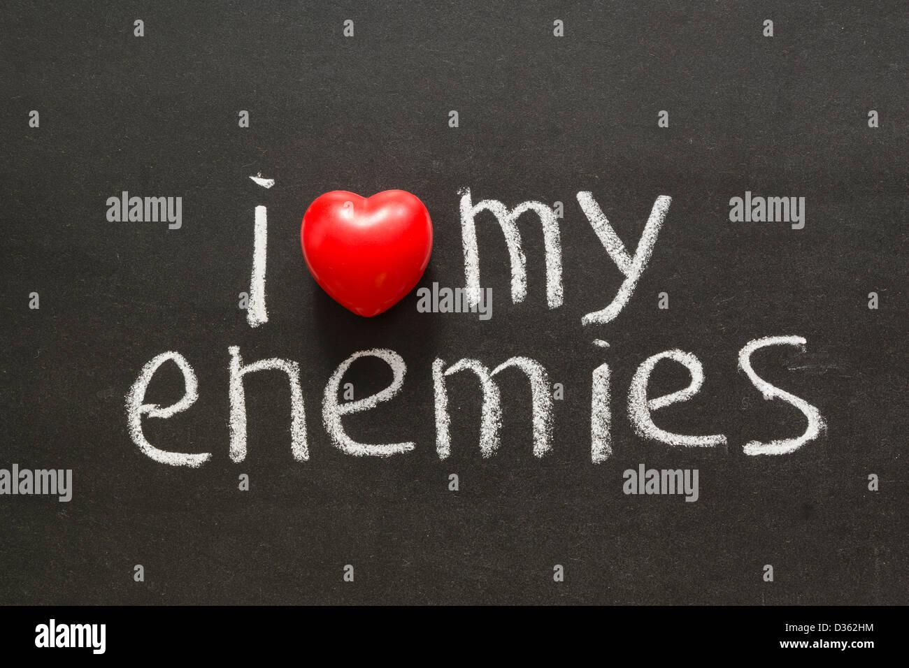 I love my enemies phrase handwritten on blackboard - Stock Image