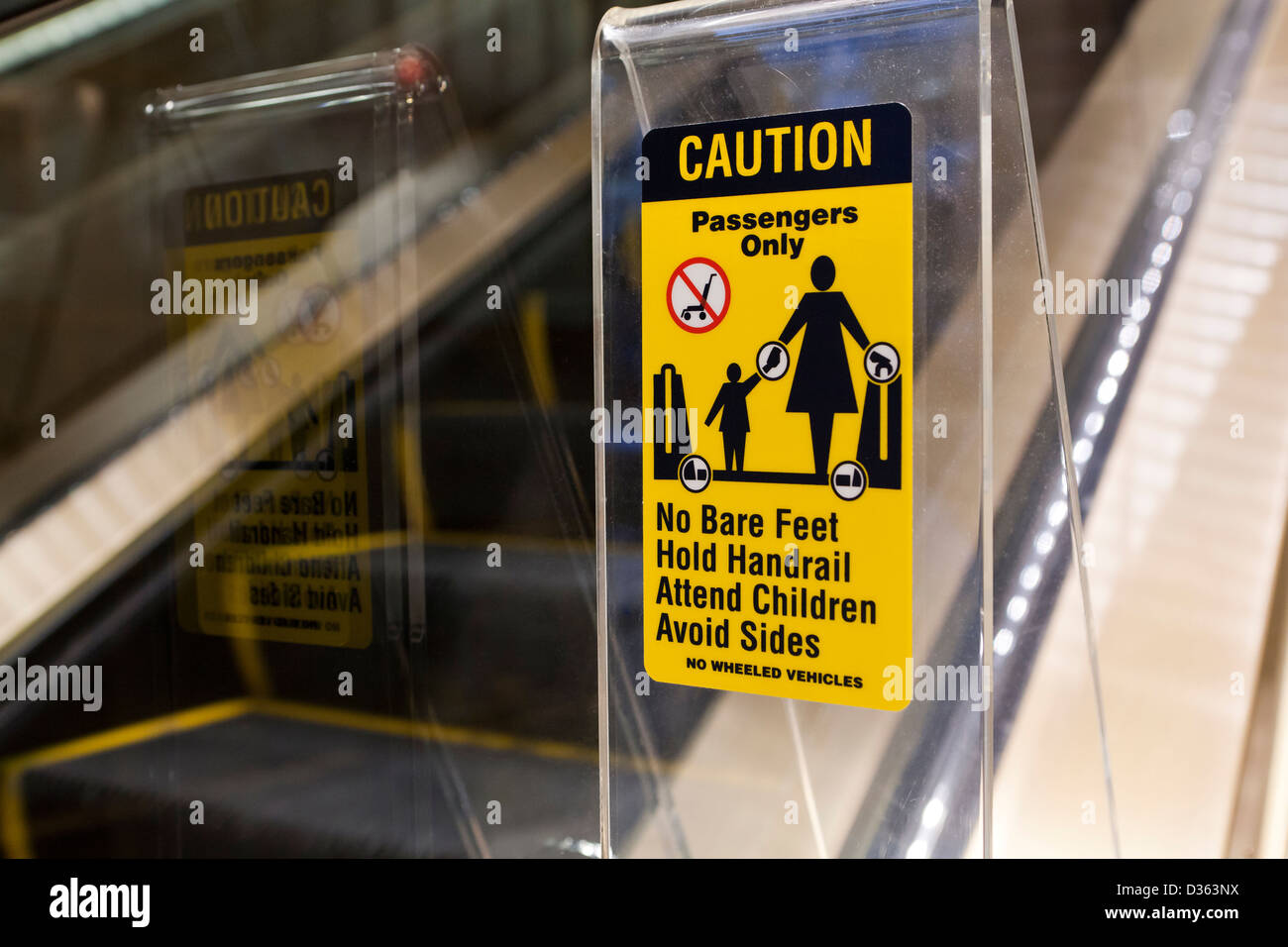 Escalator safety label - Stock Image