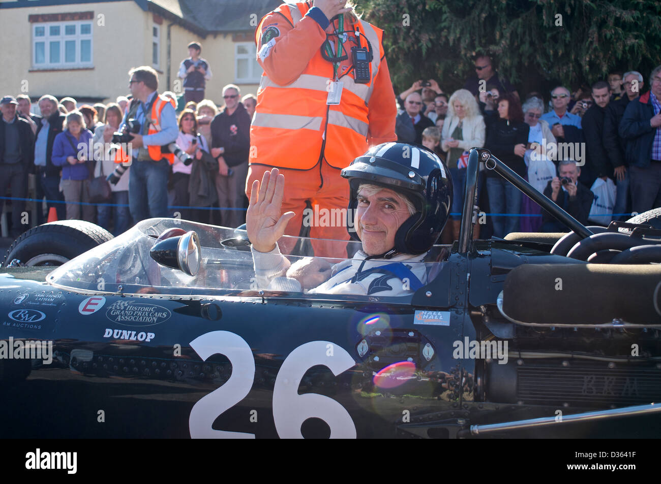 Damon Hill drives an old BRM Formula One car from the 1960's during the BRM 50th Anniversary celebrations in - Stock Image