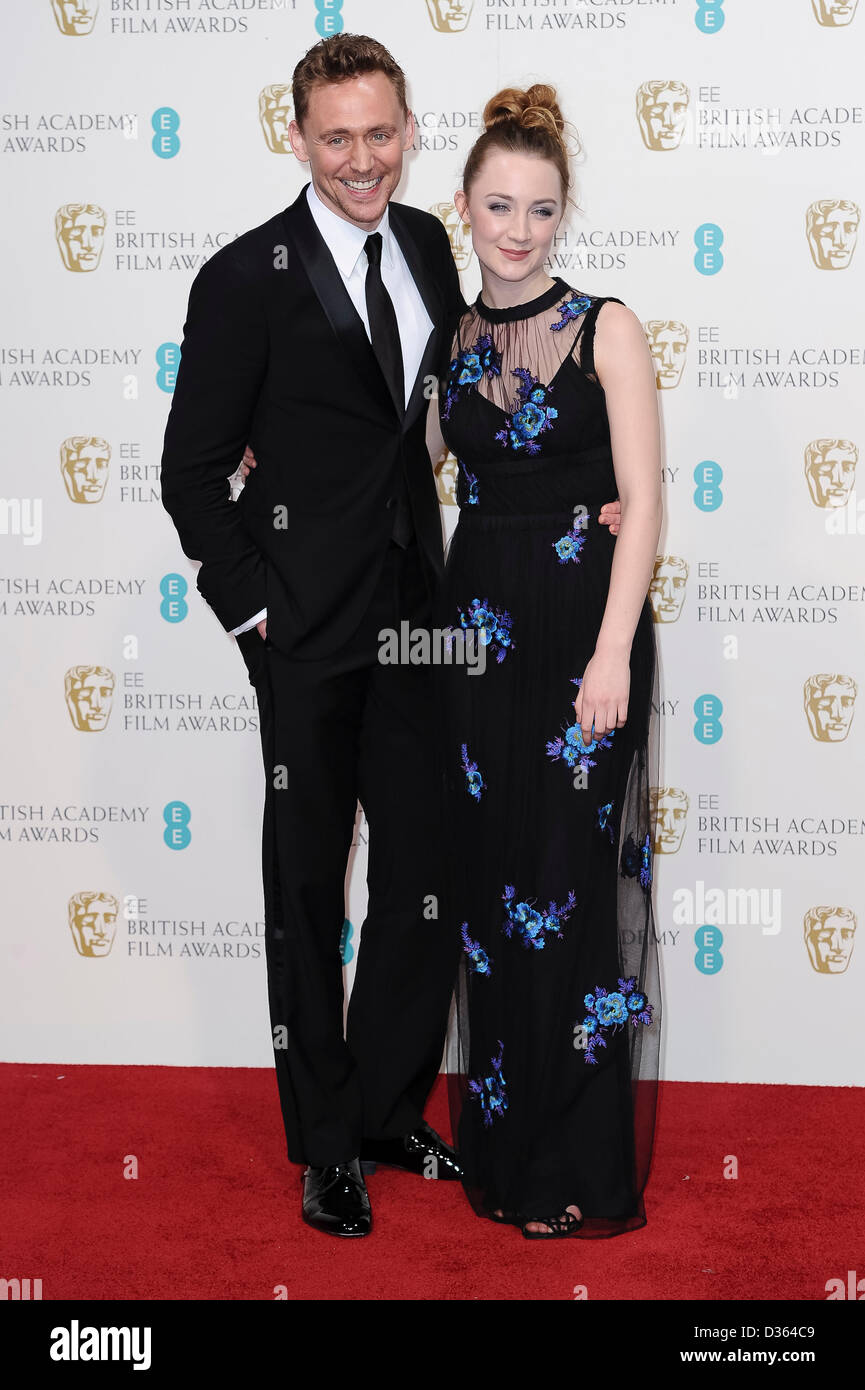 London, UK. Feb 10th, 2013. Tom Hiddleston and Saoirse Ronan pose in the press room at The EE British Academy Film - Stock Image