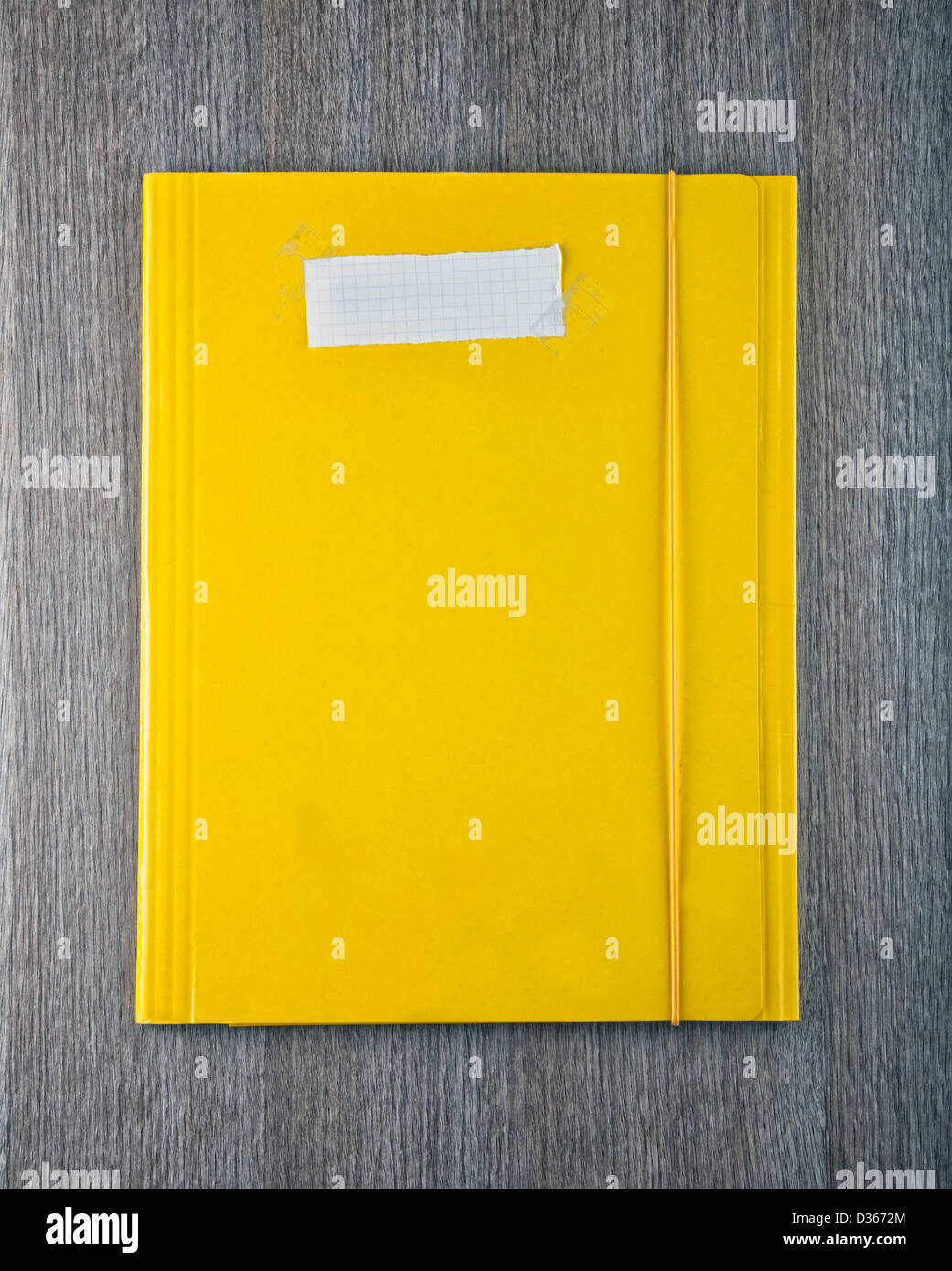 A yellow folder with empty white paper label - Stock Image