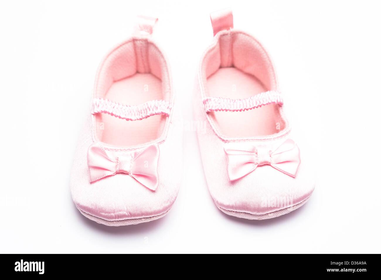 Baby girls booties - Stock Image