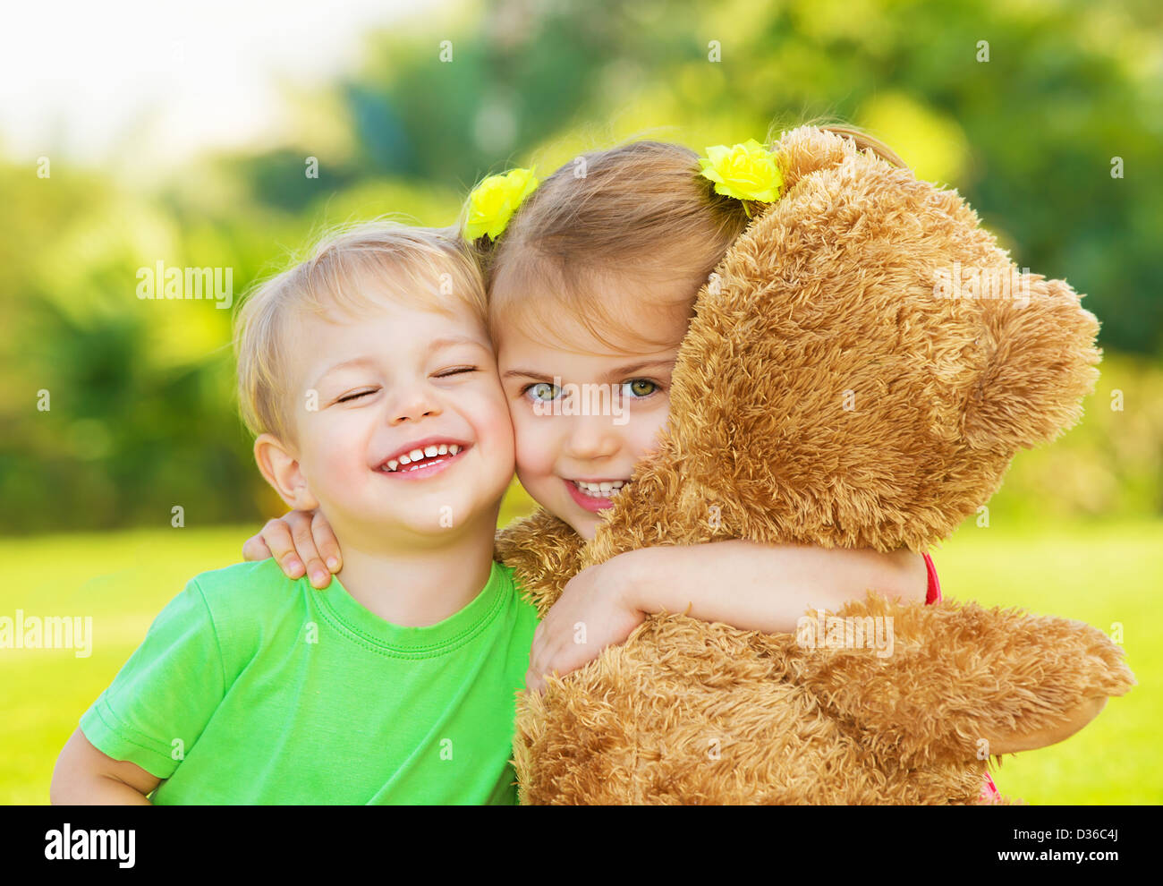 photo two cute child hugging outdoors, brother and sister having fun