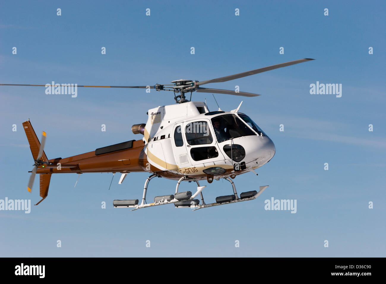 helicopter astar Eurocopter AS350B3e flying  Fugro - Stock Image
