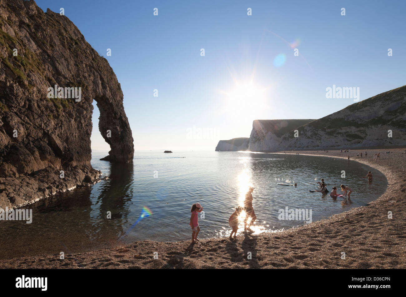 Family on Durdle Door beach, Dorset, England Stock Photo