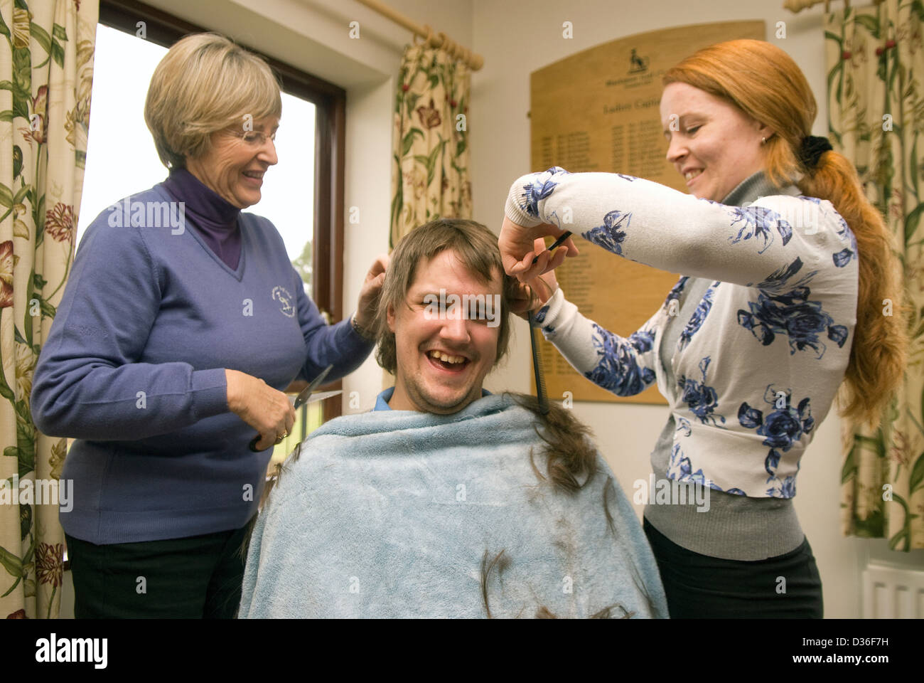 26 year old man in process of having all his hair shaved off for cancer charity, Bordon, Hampshire, UK. Stock Photo