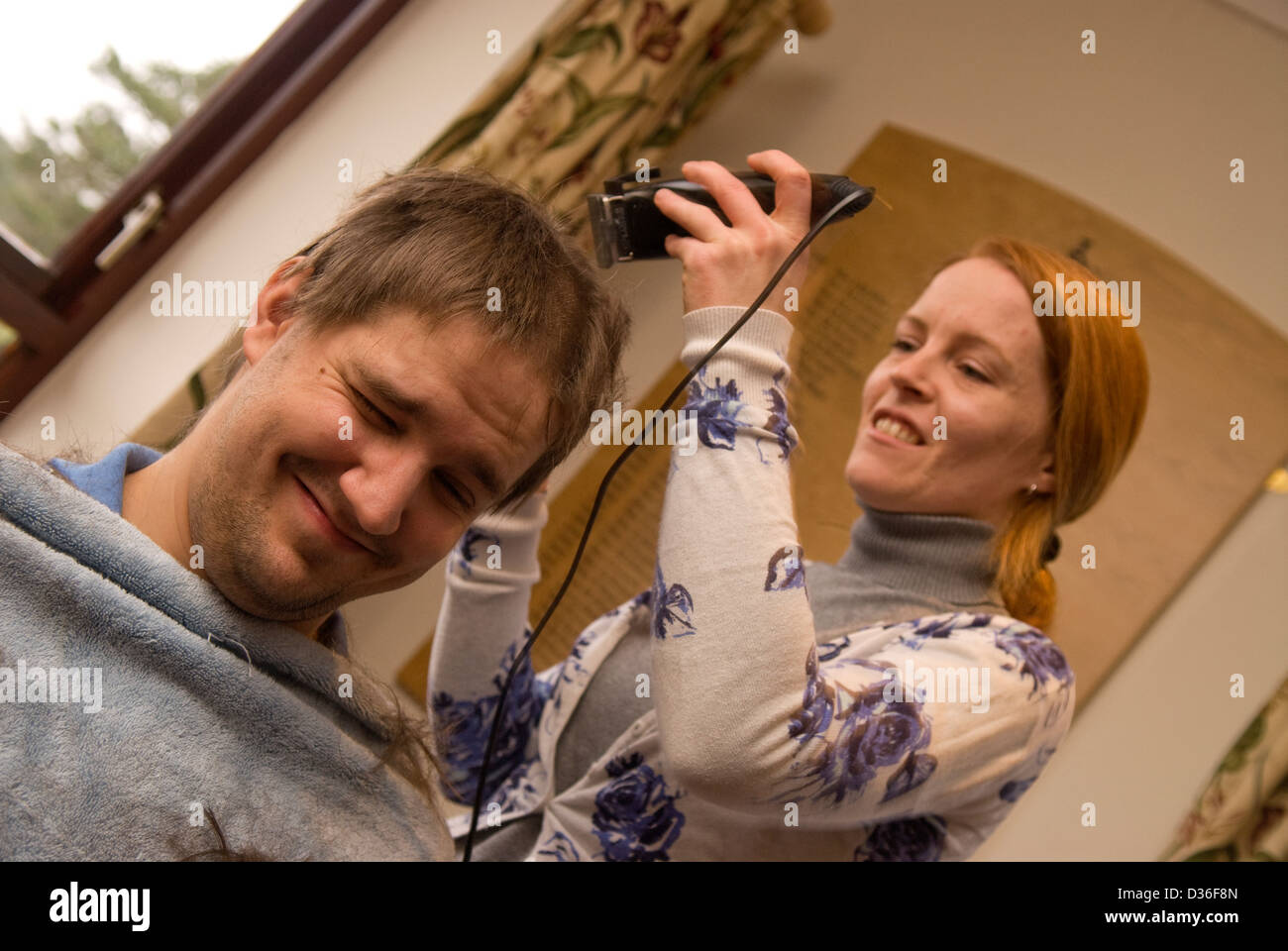 26 year old man in process of having all his hair shaved off for a cancer charity, Bordon, Hampshire, UK. Stock Photo