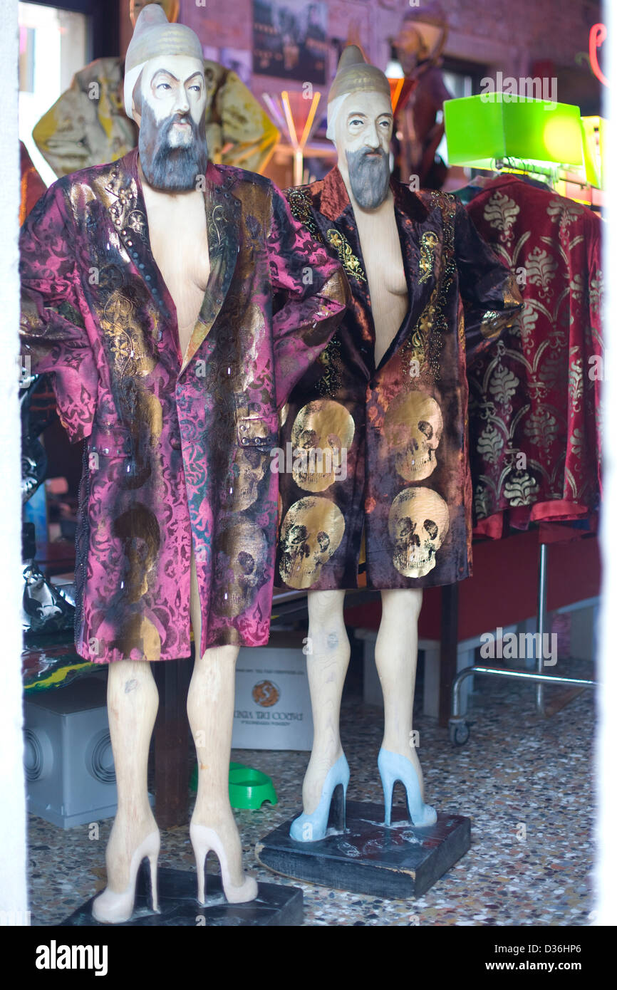 two cardboard cutouts of men in dressing gowns and high heels - Stock Image