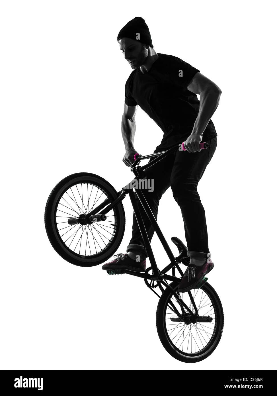 one  man exercising bmx acrobatic figure in silhouette studio isolated on white background - Stock Image
