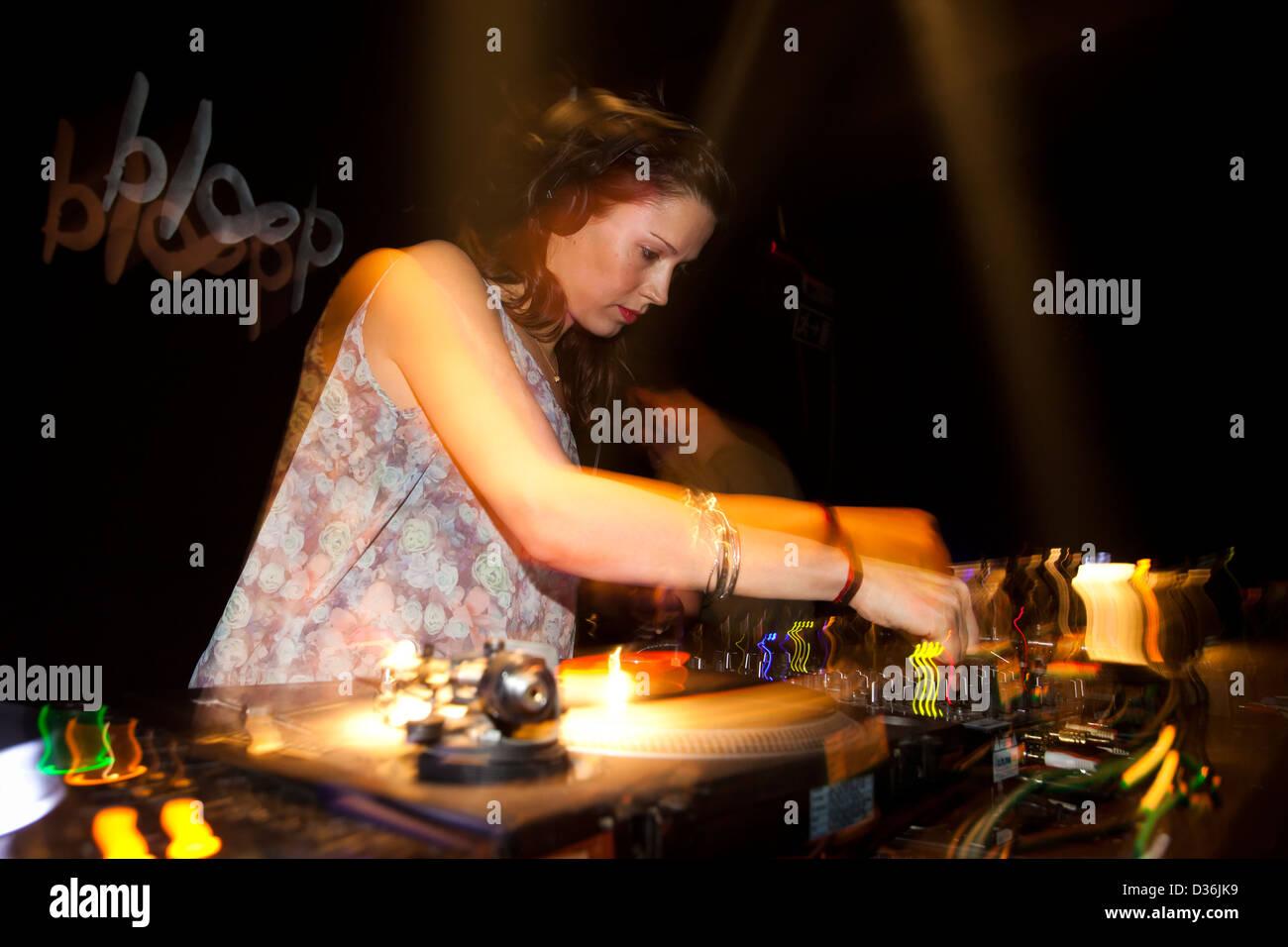 Woman DJing at a party. - Stock Image