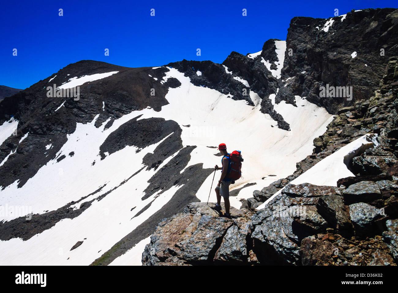 Trekker at Corral del Veleta Sierra Nevada, Granada, Spain - Stock Image