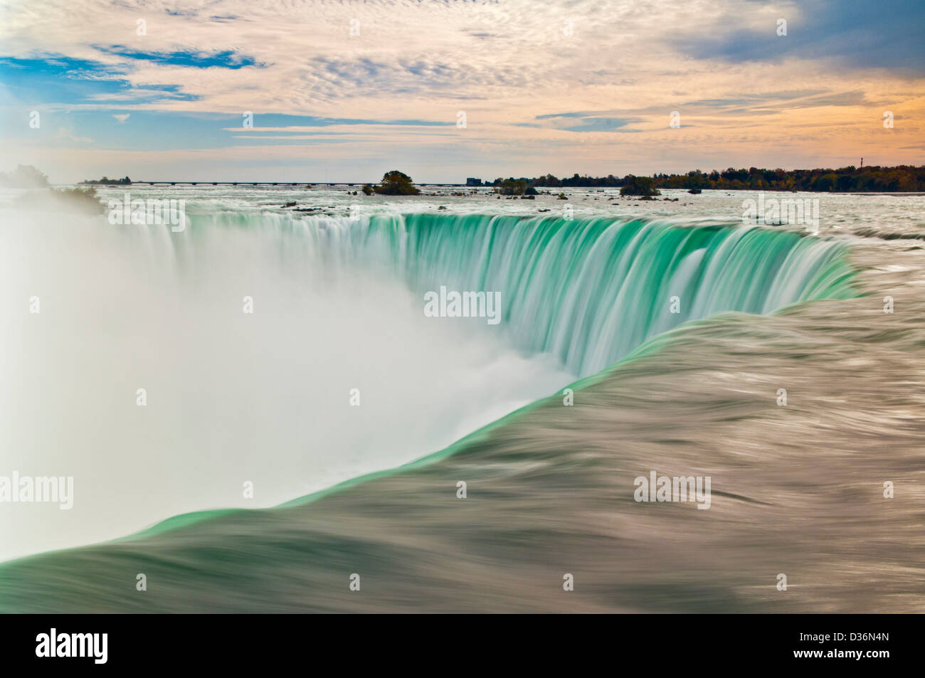 Blurry slow motion water falling over the top of the Horseshoe falls waterfall at Niagara falls Ontario Canada - Stock Image