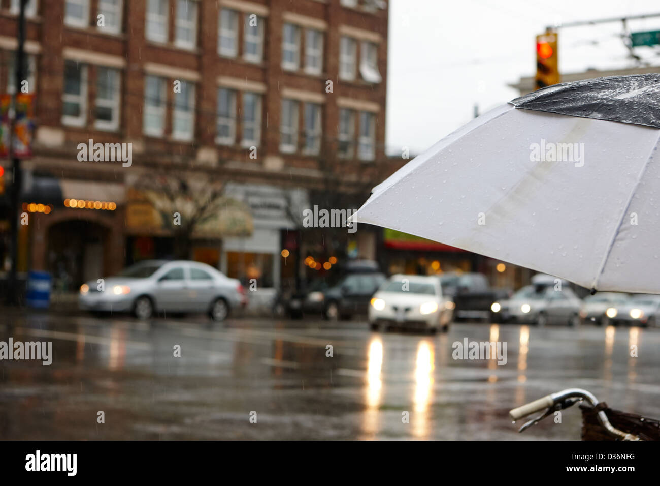 rain falling off a umbrella on a wet rainy day in downtown Vancouver BC Canada - Stock Image