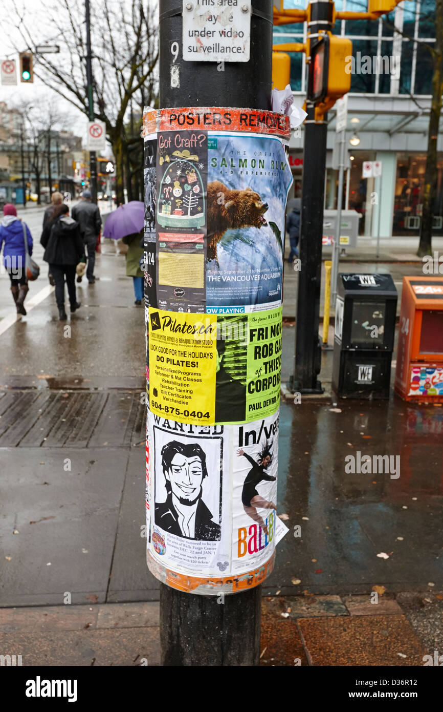 posters on a post pole where posters are removed periodically Vancouver BC Canada - Stock Image