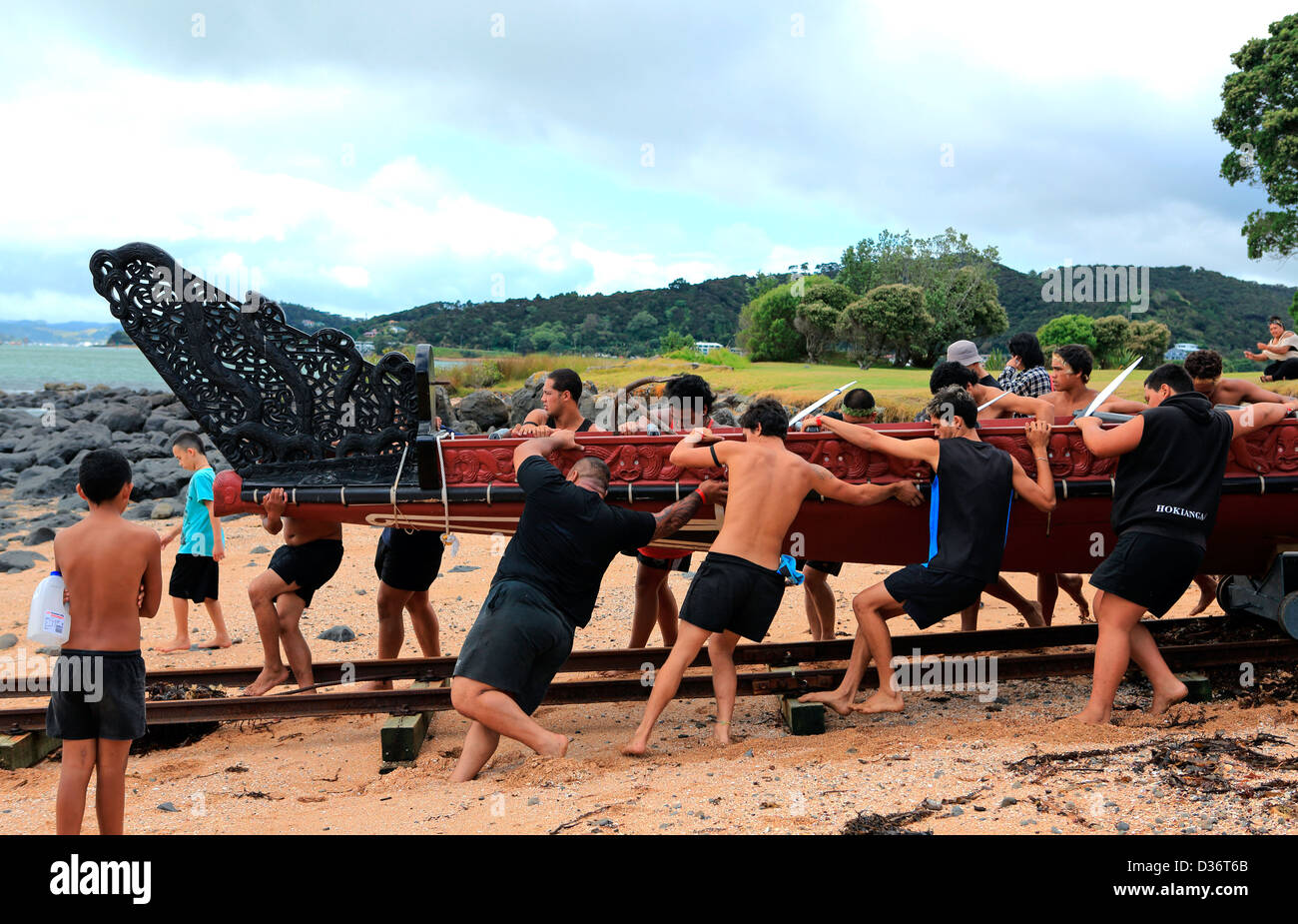 Maori waka crew with the great waka Ngatokimatawhaorua at the Waitangi Treaty Grounds during Waitangi Day celebrations. Stock Photo
