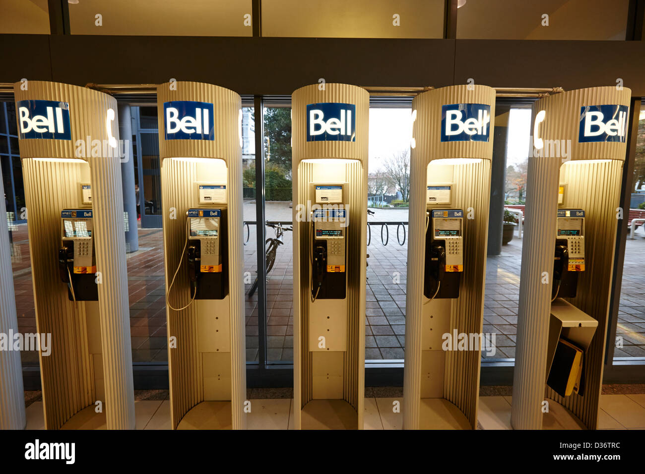 row of bell public telephones Vancouver BC Canada - Stock Image