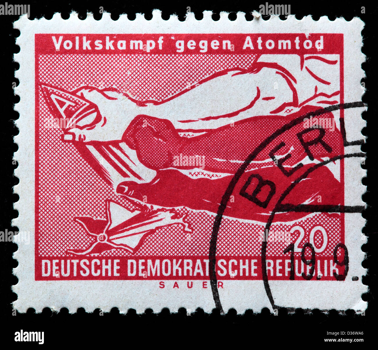Arms Breaking A-Bomb, postage stamp, Germany, 1958 - Stock Image