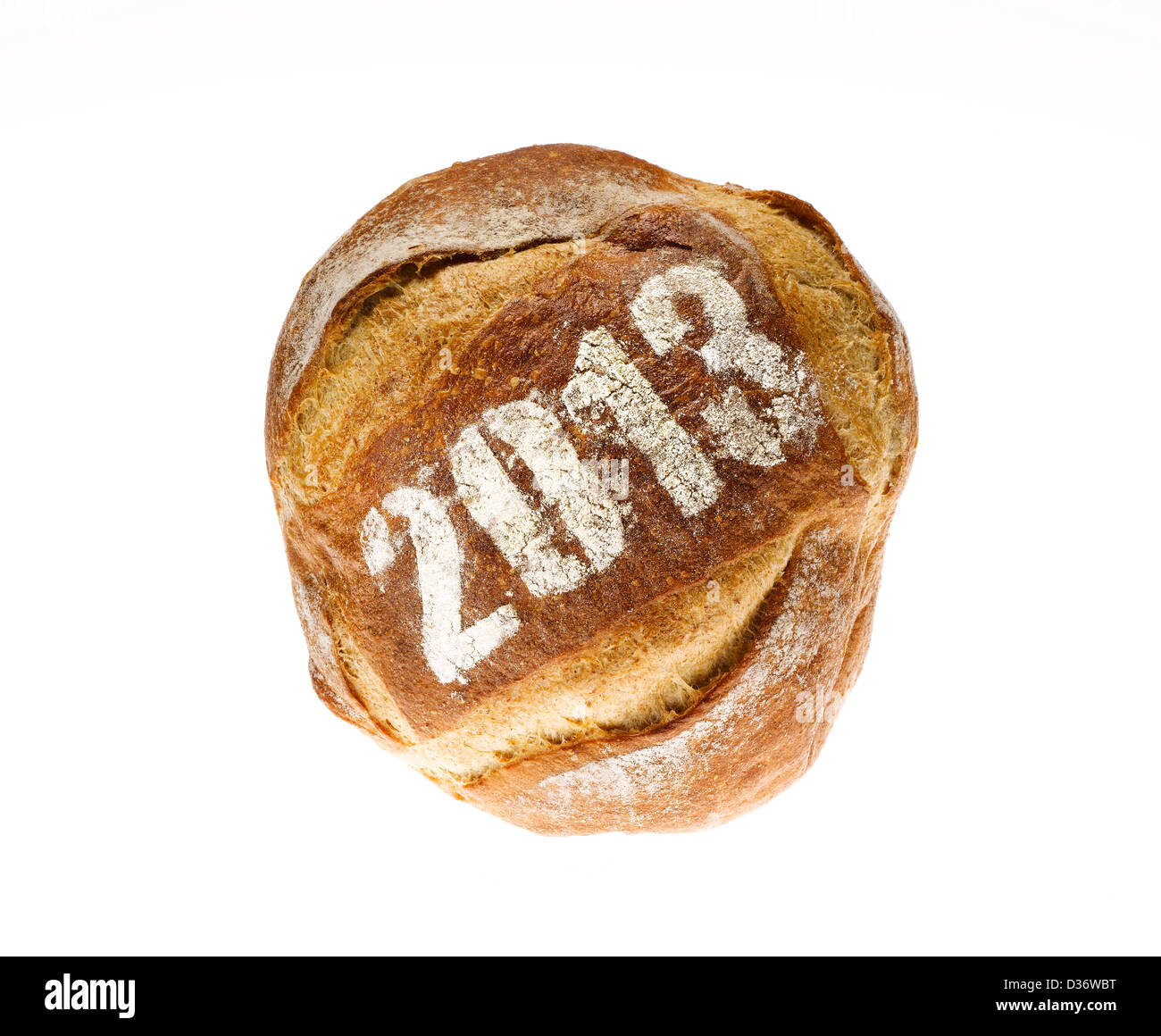round loaf of bread dusted with the year 2013 - Stock Image