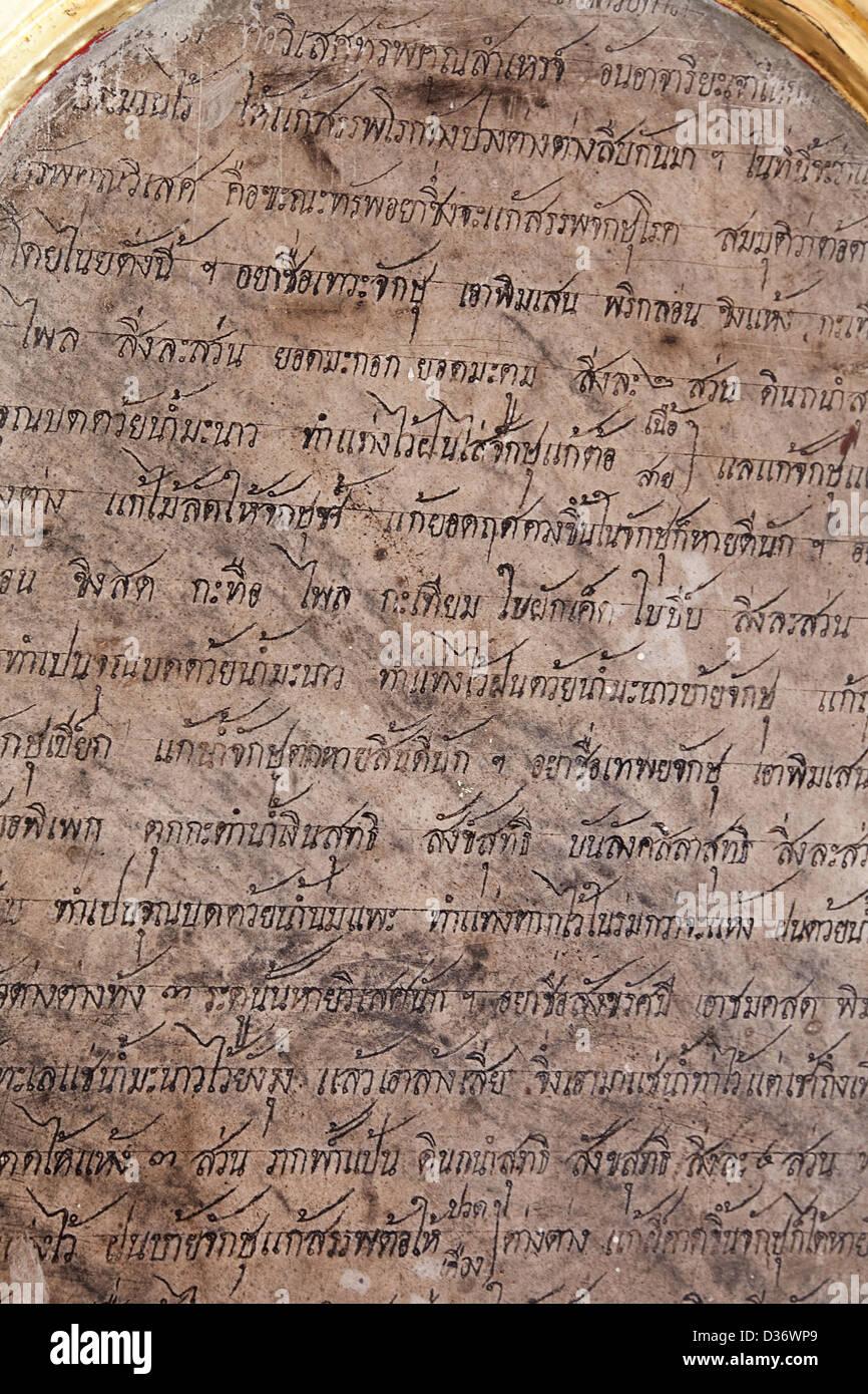 Thai Written tablet in temple Bangkok, Thailand - Stock Image
