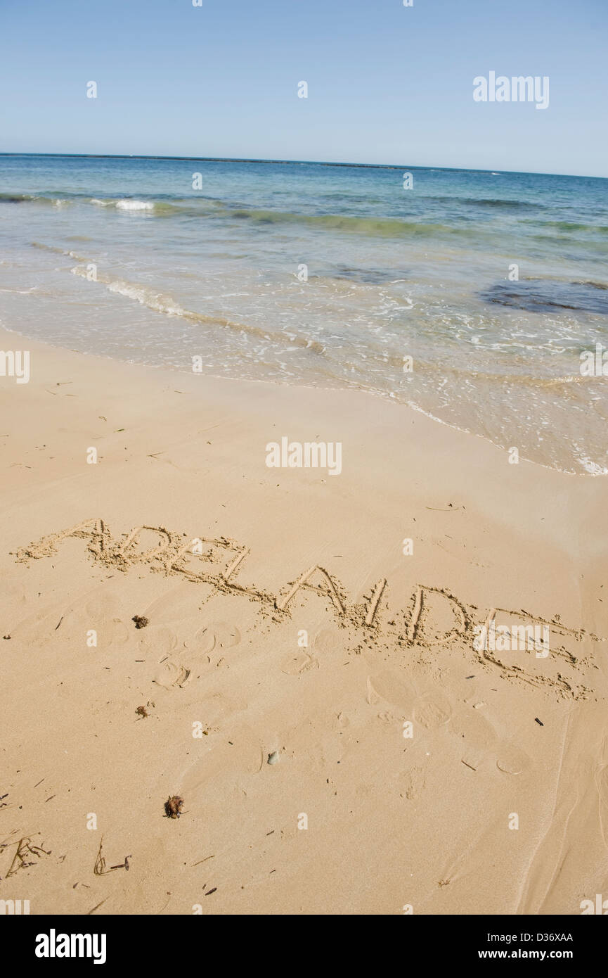The word adelaide written in the sand of a beach - Stock Image