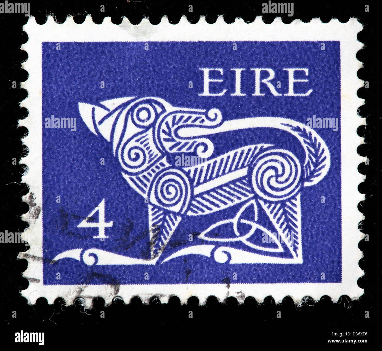 Dog from ancient brooch, postage stamp, Ireland, 1968 - Stock Image