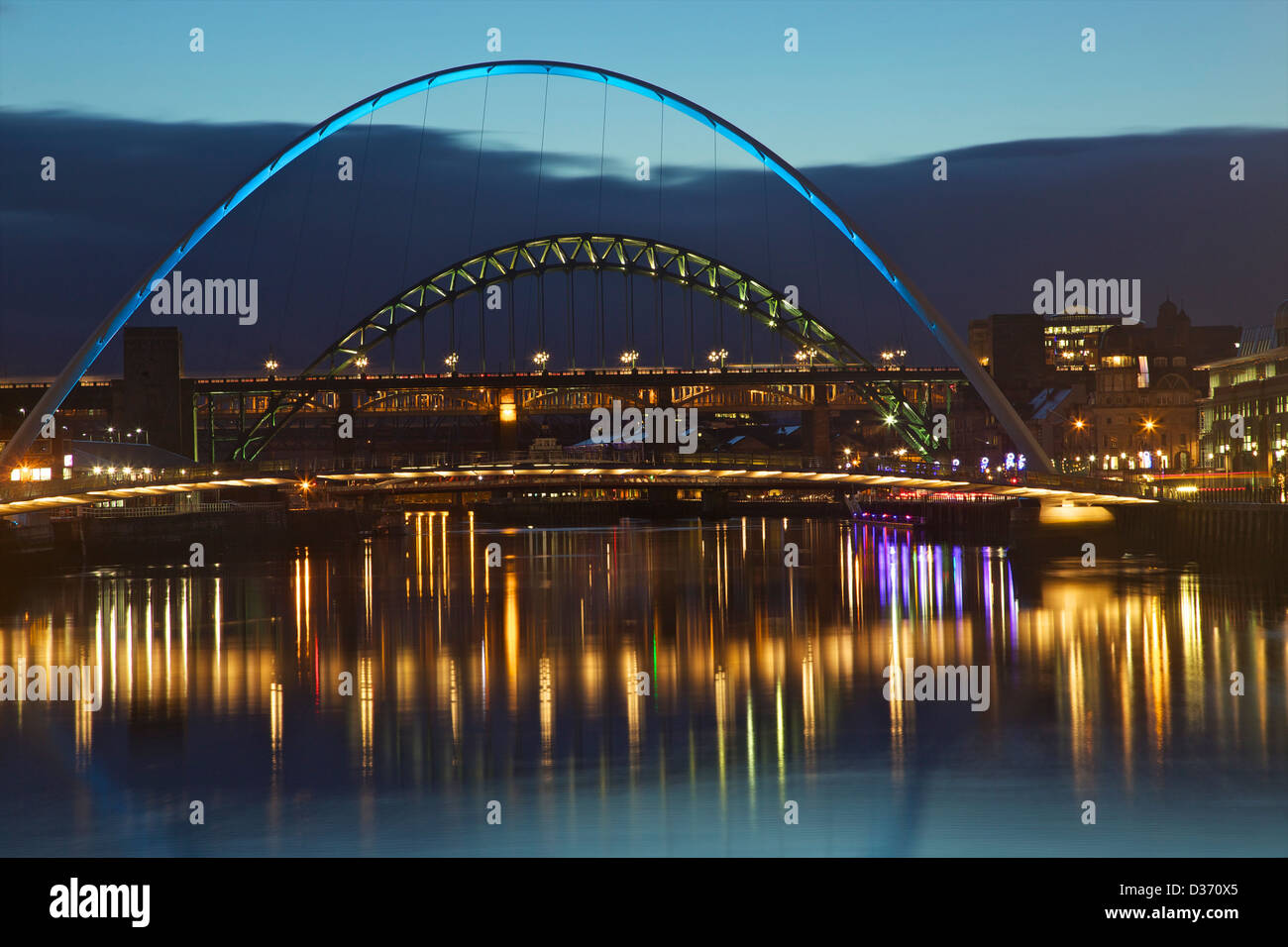 Gateshead Quays with The Sage and Millennium Bridge over the River Tyne at night, Tyne and Wear, North East England, - Stock Image