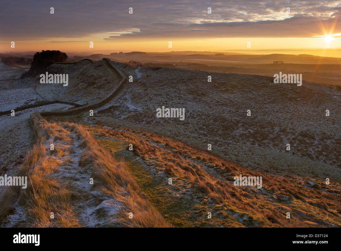 Daybreak sunrise on Hadrian's Wall National Trail looking to Housesteads Fort from Cuddy's Crags Northumberland Stock Photo