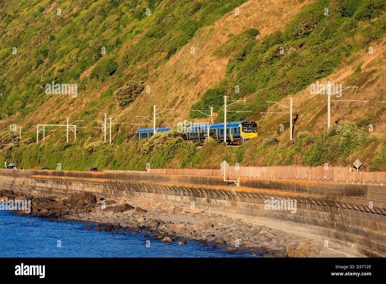 The Metlink Kapiti line train on the Kapiti coast highway between pukerua Bay and Paekakariki. Stock Photo