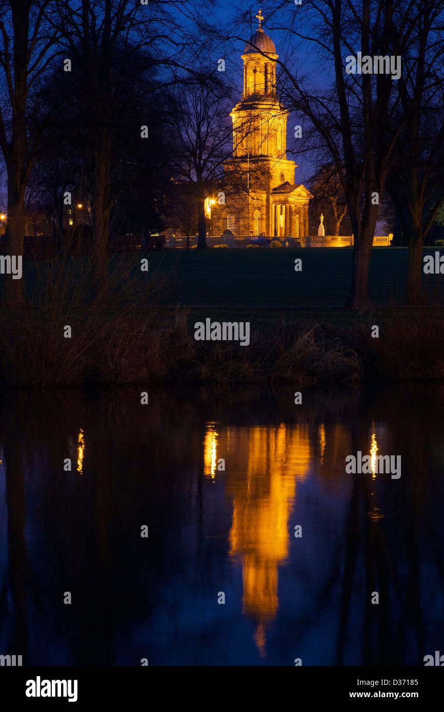 St Chads church illuminated at night, reflections in River Severn, Quarry Park, Shrewsbury, Shropshire, England, - Stock Image