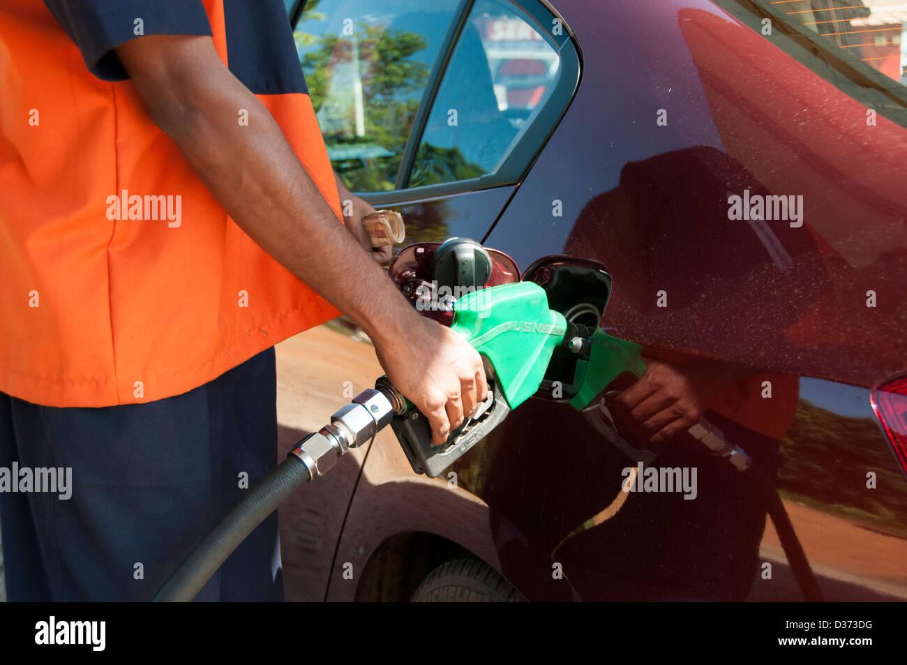 Filing a car with petrol in kerala, India - Stock Image