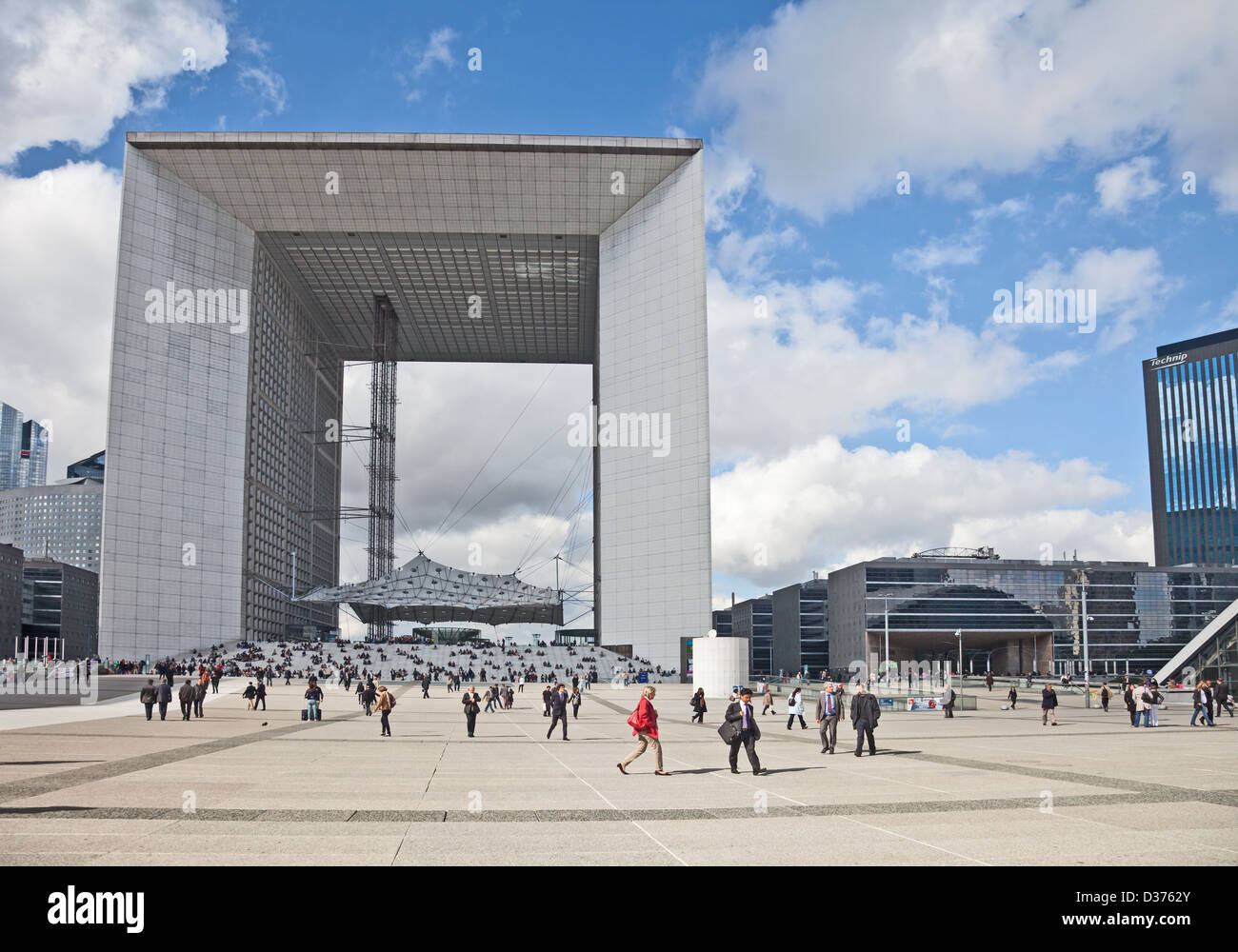 Editorial photo of visitors to and workers in La Defense business area in west-central Paris in front of La Grande - Stock Image