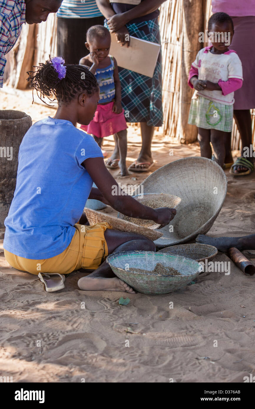 African woman sifting food - Stock Image