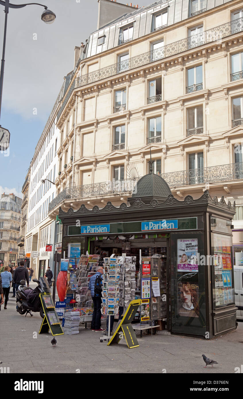 A news kiosk on a street in central Paris. selling goods including magazines,newspapers, postcards and soft drinks - Stock Image