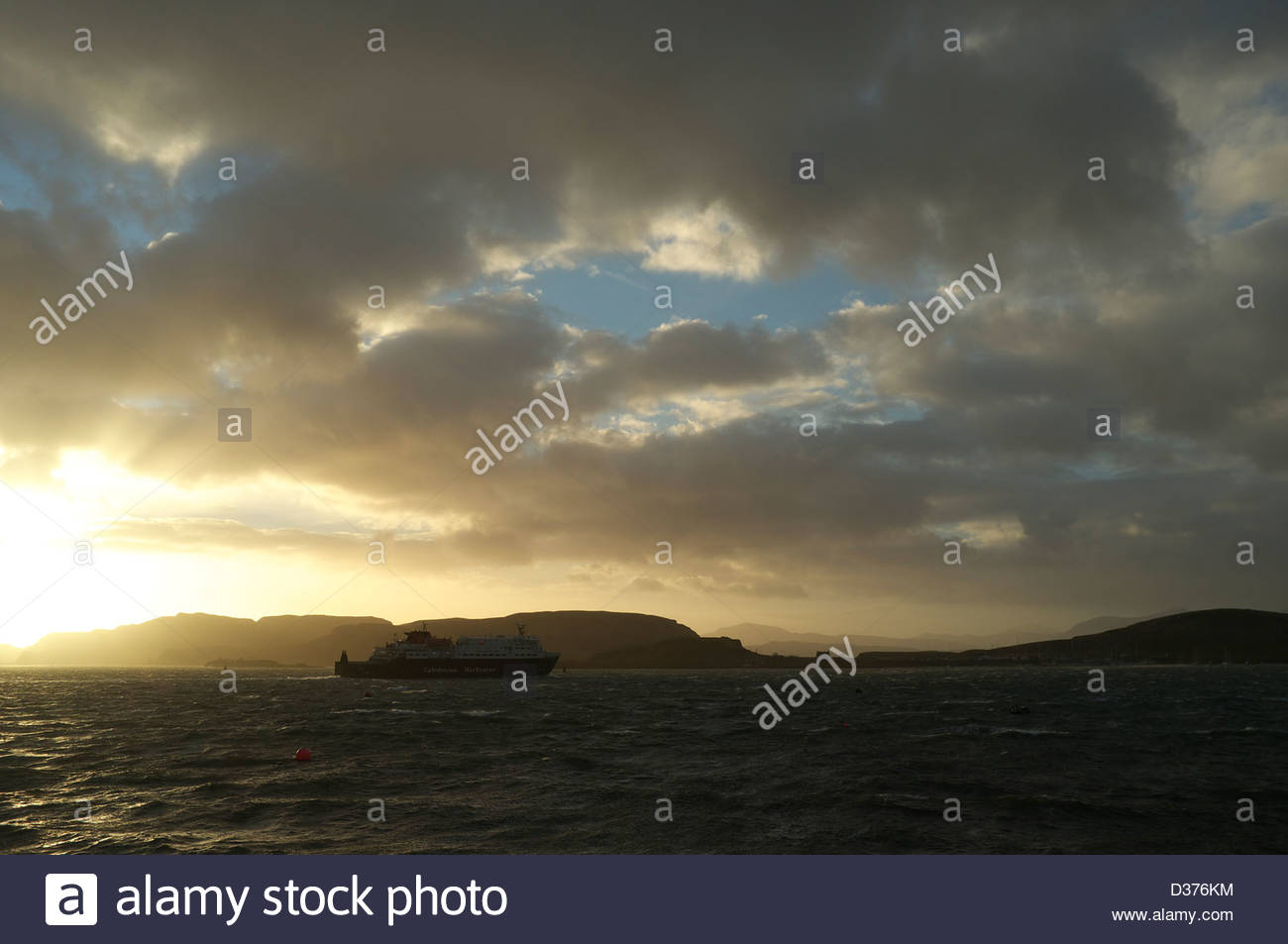 Calendonian MacBrayne ferry leaving Oban, during a windy winter's afternoon, Scotland, UK. - Stock Image