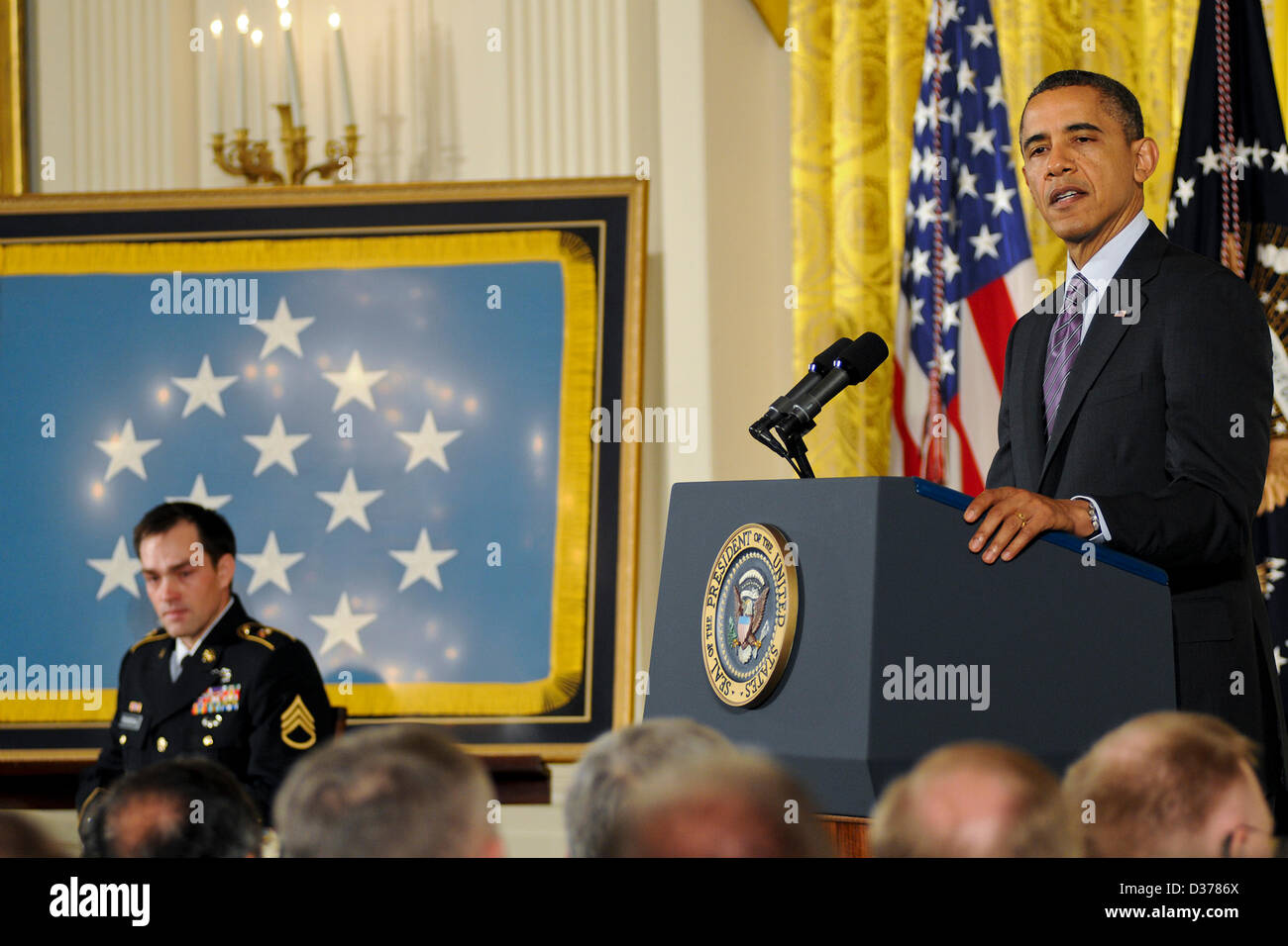 US President Barack Obama speaks before presenting the Medal of Honor to Army Staff Sergeant Clinton Romesha during - Stock Image