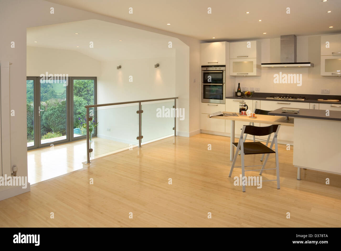 Brand new contemporary split level kitchen in a new house. - Stock Image