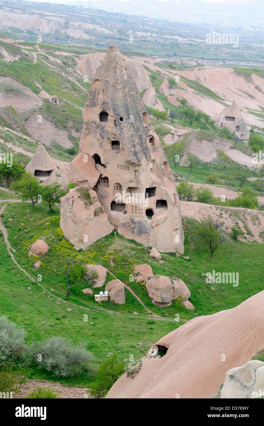 Tuff Hills with dovecotes and storage spaces Uchisar Cappadocia Turkey - Stock Image