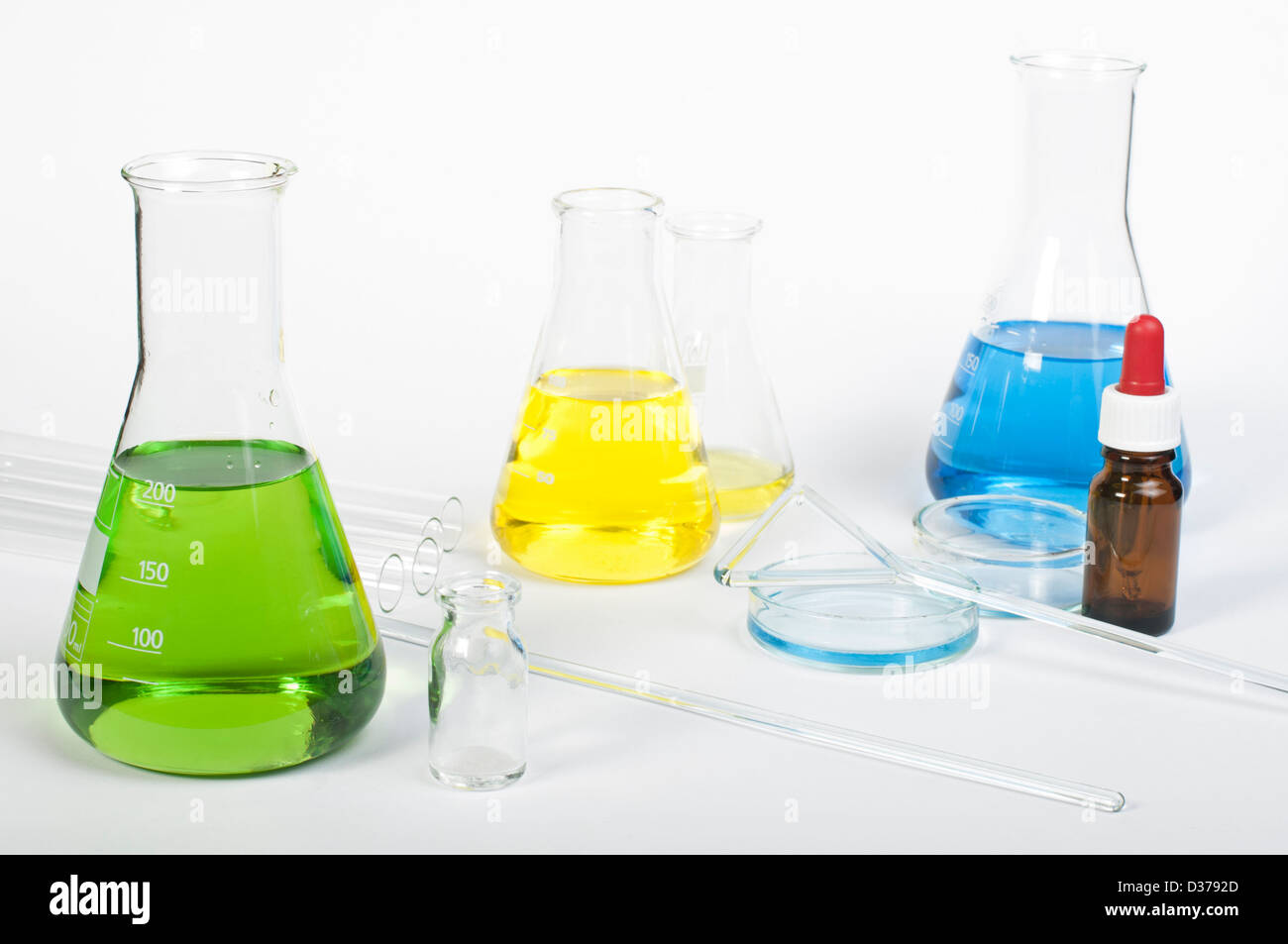 Laboratory glassware equipment. Laboratory beakers filled with colored liquid substances Stock Photo