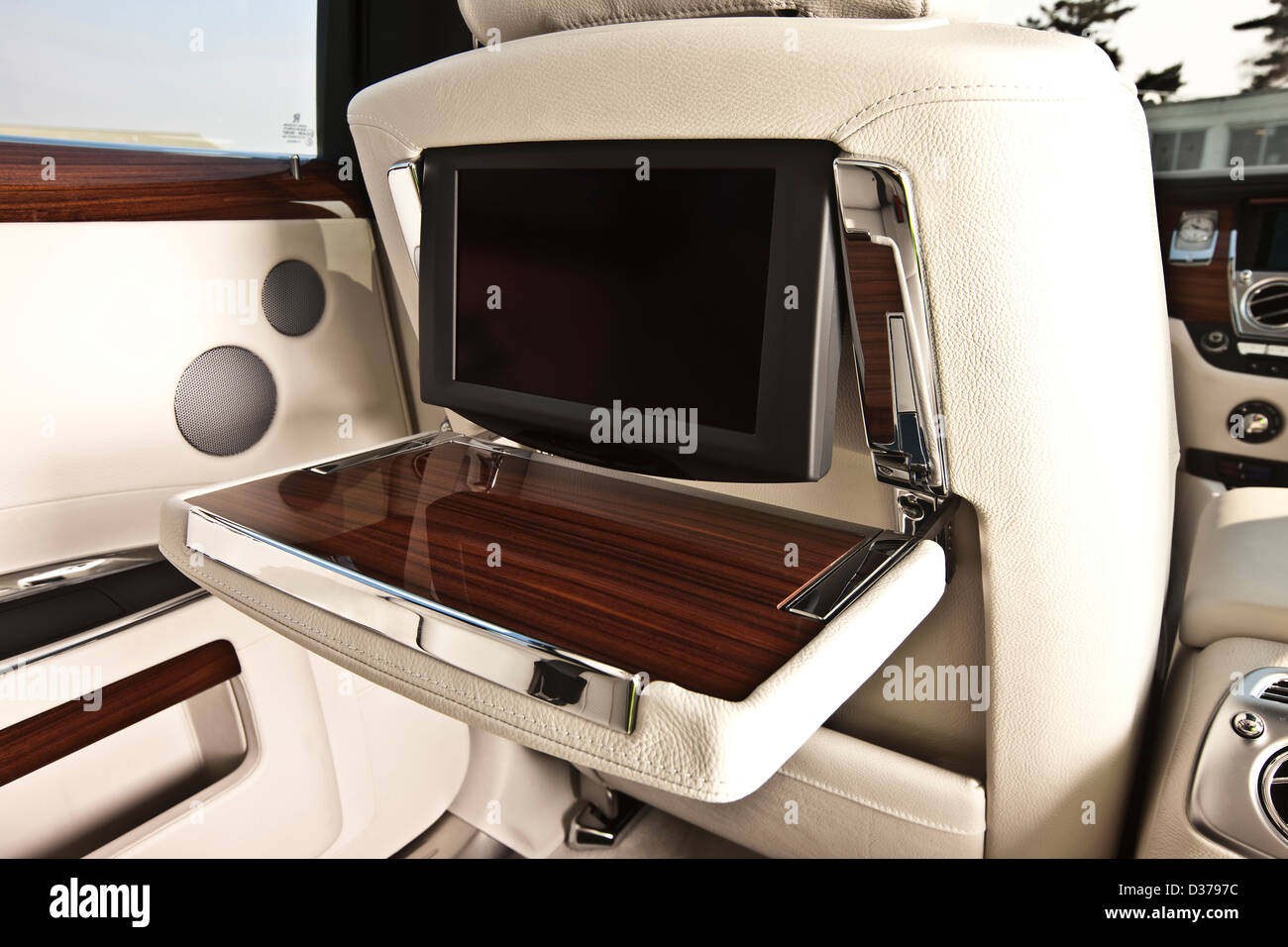 Concealed plasma screen in seat back, Rolls Royce Ghost luxury saloon car, Goodwood, UK, 15 04 2010 - Stock Image