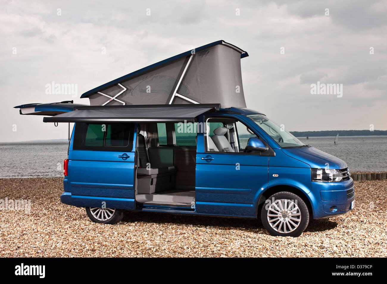 Blue metallic VW California campervan with optional awning on Southampton beach, UK, 07 05 2010 - Stock Image